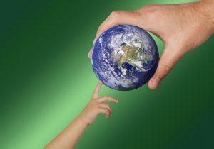 Parent and Child touching globe